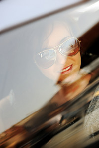 Beauty woman in moving car