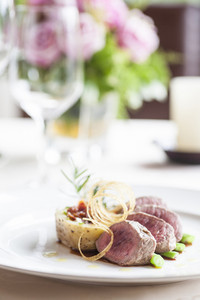 Beef medallions food on white dish