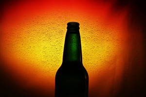 Beer Bottle Against Abstract Beer Bubble Texture