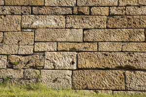 Big brown sand stone wall texture and background