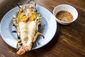 Big prawn on dish with spicy sauce