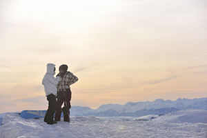 Snowboarder's couple on mountain's top