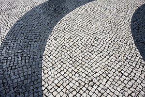 Black and Beige vintage square mosaic cobblestone pavement with curly pattern from Macau China