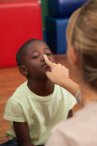 Black boy playing in the kindergarten