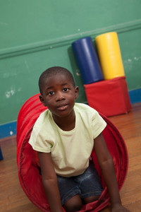 Black boy playing in the kindergarten