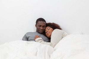 Black couple in love in the bed