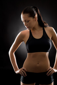 Black fitness-portrait of young beautiful sportive woman