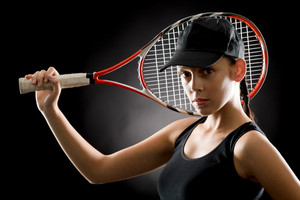 Black tennis- portrait of female player with racket