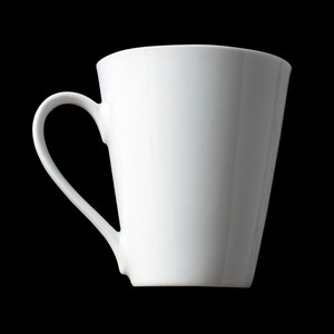 Blank white coffee cup isolated over a black background.