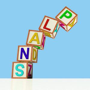 Blocks Spelling Plans Falling Over As Symbol For Failing Goals