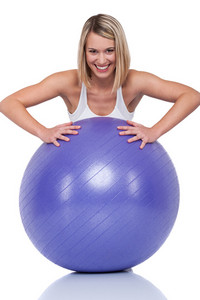 Blond smiling woman with purple ball on white background