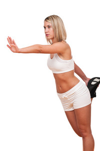 Blond woman exercising on white background