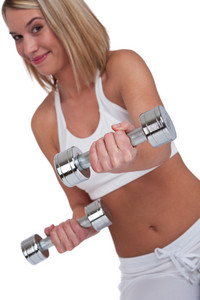 Blond woman on white background,focus on hand and weights