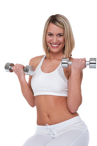 Blond woman with weights on white background