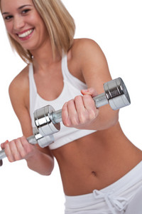 Blond woman with weights on white background,focus on hand