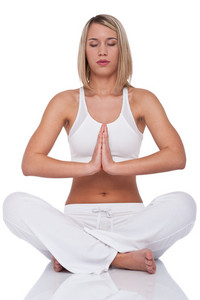 Blond young woman in yoga position on white background