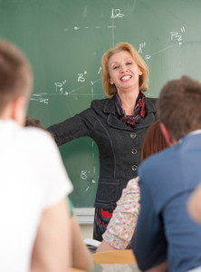 Blonde caucasian teacher giving a lecture to her students
