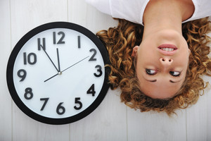 Blonde girl and clock