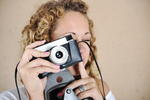 Blonde girl with retro camera