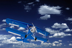 Blue Biplane On The Sky