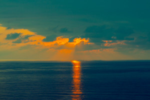 Blue cloudy sunset over sea