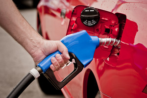 Blue Gasoline Nozzle In Red Car