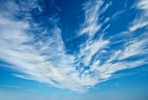 Blue sky with feather clouds