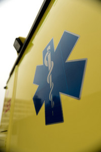 Blue star paramedics symbol on yellow ambulance car