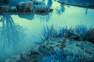 Blue vintage mystical rocky river bank
