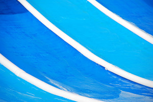 Blue Waterslide In A Water Park
