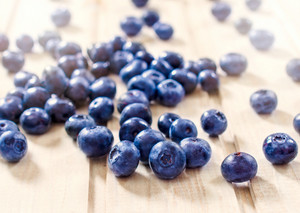 Blueberries On The Wooden Table