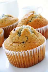Blueberry Muffins On White Background With Coffee Cup