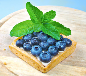 Blueberry shortcake decorated with mint