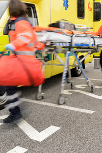 Blurry hurrying paramedics running to help with gurney