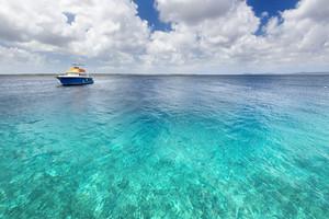 Boat in tropical ocean waters