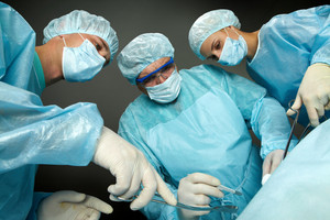 Bottom view of three surgeons operating