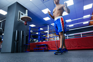 Boxer warming up with skipping rope