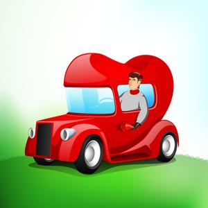 Boy Driving Heart Shaped Vehicle
