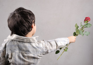 Boy giving a rose