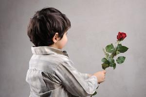 Boy giving a rose