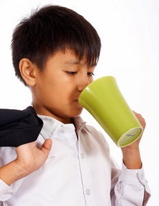 Boy In A Suit Drinking From A Mug