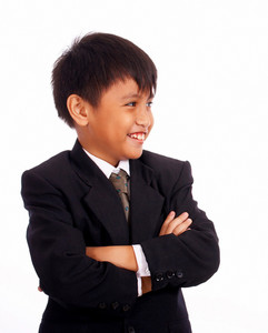 Boy In A Suit With Arms Folded