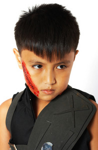 Boy In Costume With Fake Scar