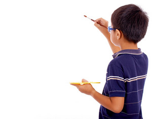 Boy Painting On A Blank Canvas
