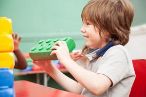 Boy playing in kindergarten