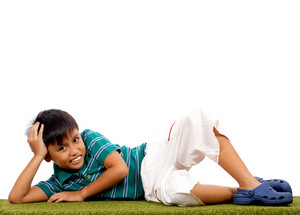 Boy Relaxing On The Grass