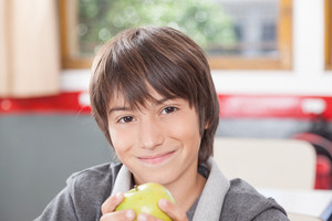 Boy sharing a apple
