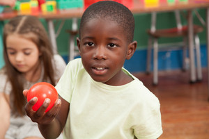 Boy sharing a plastic ball