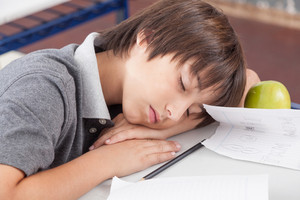boy sleeping in class