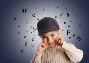 boy with denim cap, letters of alphabet on background